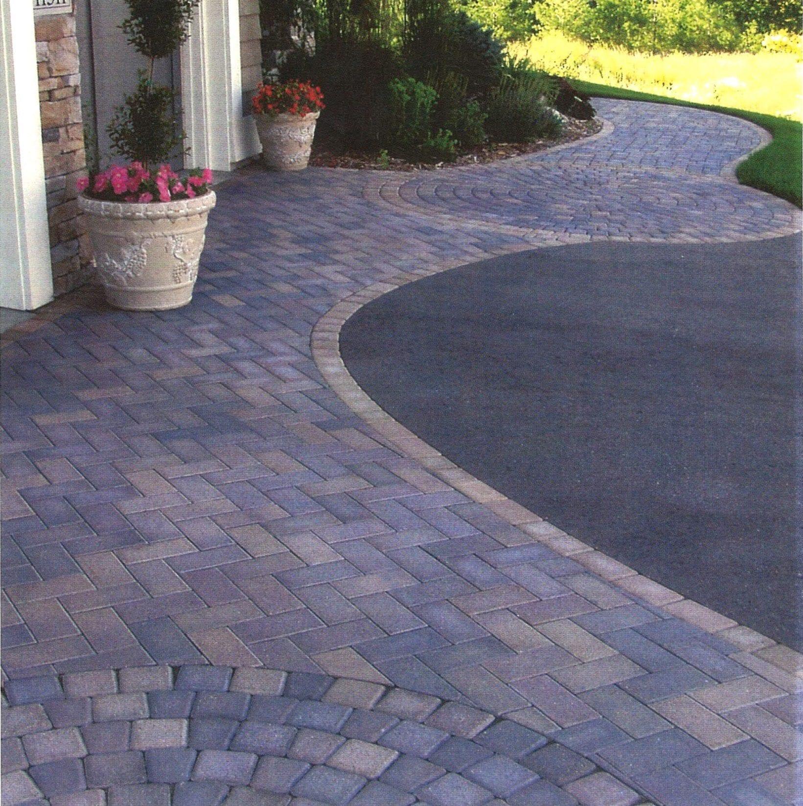 paver walkway and asphalt driveway
